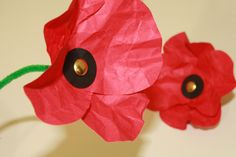 Making crumpled paper poppies with split pins, coloured paper and pipe cleaners...