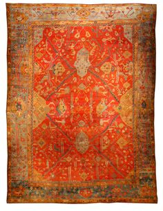 A Turkish Oushak rug BB1378 - by Doris Leslie Blau.  A late 19th century antique Turkish Oushak rug, the bold tomato red field with blue serrated tracery lines forming ...
