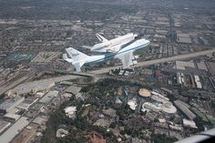 Kill two nerds with one stone. Space shuttle Endeavour, on its final flight, flying over Disneyland = my childhood.