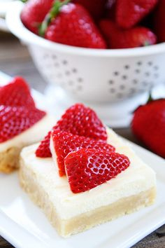 Strawberries and Cream Bars Recipe on twopeasandtheirpod.com Sugar cookie bars topped with white chocolate cream cheese frosting and strawberries. The perfect dessert for spring and summer!