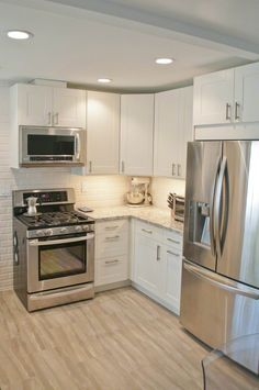 IKEA Adel cabinetry in off white, Cambria countertops in Bellingham and a sandy gray tile