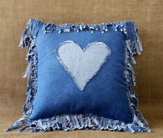 Denim Fringe Pillow Handmade from Recycled Blue Jean Denim. All recycled fabrics are thoroughly washed before using. Thank you so much for browsing my shop and supporting my love of recycling! Do you make anything using recycled material if so what?