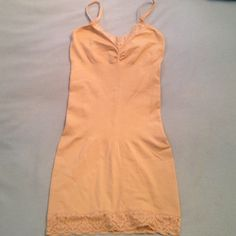 Nude colored slimming slip Worn once... Nude colored slimming slip. Top has lace accent and rouching. Bottom has lace accent and non slip rubber on the inside so that it stays in place. Smoothes out tummy and hip area. I have 2 of these if you are interested Dress Barn Intimates & Sleepwear Shapewear