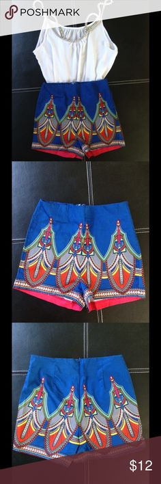 Blue patterned shorts Small shorts that's high waisted. With pretty red, yellow and green patterns. Like new. Love it with white top as displayed!  Shorts