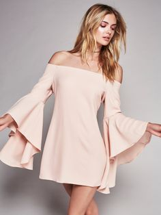 Let's Dance Mini | Australian made off-the-shoulder mini dress with an elastic band at the neckline for an easy fit. Statement flared sleeve with a dramatic cuff. Hidden back zip. Lined.