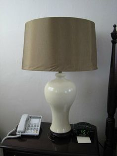 How to turn a lamp shade that uses a harp so that you can use a shade that doesn't use a harp.
