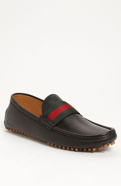A striped webbing strap tops a modern driving shoe set on a classic nub sole. Color(s): black. Style Name: Gucci 'New Auger' Driving Shoe. Gucci Mens Sneakers, Gucci Loafers, Gucci Shoes, Hot Shoes, Men's Shoes, Shoe Boots, Dress Shoes, Gucci Slip Ons, Mature Mens Fashion