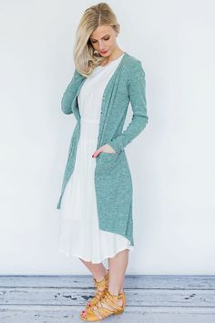 Long duster cardigan featuring a button up front and pockets! Lightweight, ribbed material makes it a stylish layering piece to go from winter to spring, or for those cooler nights when you just need an extra layer. We love it buttoned up or left open, and paired with jeans, leggings, dresses or skirts!