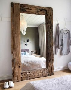 What a great way to make your home look bigger and more grandiose. Big mirrors can do that. You can put big mirrors in any corner of the house. Chic Retro, Home Interior, Interior Design, Reclaimed Wood Frames, Wood Mirror, Rustic Chic, Decorating Your Home, Sweet Home, New Homes