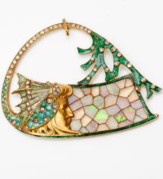 Art Nouveau pendant, by Georges Fouquet, circa 1900-1905, composed emeralds, diamonds, enamel and opals, mounted in gold.