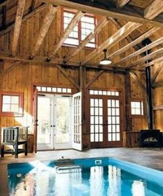 Indoor swimming pool that looks like its in a barn. Pretty cool. :)