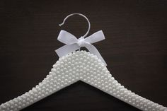 This item is unavailable Pearl Covered Hanger. Custom Wooden Hanger For The Bride. by ScaleAndTailor o New Crafts, Diy Home Crafts, Wooden Coat Hangers, The Bride, Personalized Hangers, Bride Hanger, Origami, Wedding Book, Handmade Wooden