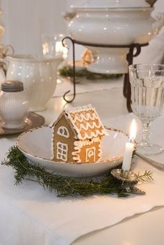 Totally want to make mini gingerbread houses!  Love this display idea...edible glitter too, perhaps.