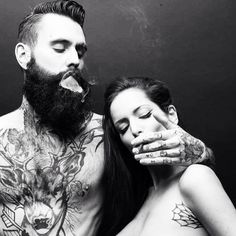 bearded man with tattoos and lady