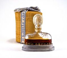 1944 Hattie Carnegie No. 7 figural perfume bottle and stopper, clear glass, gilt label and detail, fabric box. 2 1/2 in.