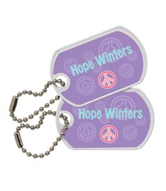 Keep track of your bags with our tough, personalized metal ID tags. Mabel's metal Bag Tags and Teeny Tags™ attach to everything from backpacks to pencil cases. These custom metal name tags are available in two sizes: Teeny Tags™ are smaller personalized tags, while Bag Tags are ideal on larger items and make perfect luggage ID tags.