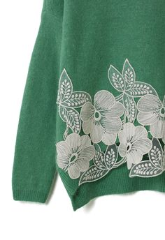 green knit sweater with pretty floral lace detail