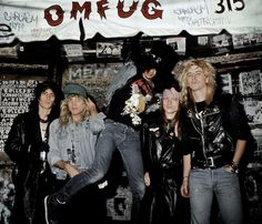 Guns n' Roses signing their record contract with Geffen at NYC's legendary venue, CBGB's on this day in 1986    Left to right - Izzy Stradlin, Steven Adler, Slash, W Axl Rose and Duff McKagen