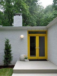 Mid Century house with Yellow doors