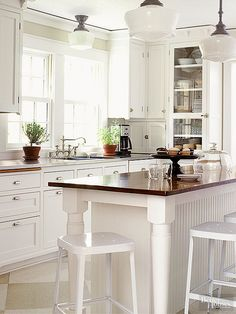 Bring vintage style to your kitchen by adding an island that ties together the new and old. This island base was built to fit a vintage wood top that was originally part of a farmhouse table. The beaded-board work space also features a counter overhang that provides room for simple family seating.