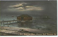 """This is the Magnolia Bluff """"bath"""" house on Scenic Highway in East Pensacola Heights, probably about 1900-1915. This would be about where Skopelos and Apple Market are today. A city trolley ran from Pensacola to Scenic Highway and Blount where Magnolia Beach/Bluff was. It apparently was a popular local tourist place and even had a railroad stop/platform. Bath houses were popular before people had bathtubs and indoor bathrooms. Dipping in the bay, even with a bathing suit, was cleansing."""