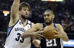 Tim Duncan drives to the basket on Marc Gasol, during Game 4 of the 2013  Western Conference finals NBA basketball playoff series