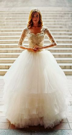 Fairy tale princess wedding dress with long sleeves and a poofy tulle skirt!  #wedding #bride #fashion #princess