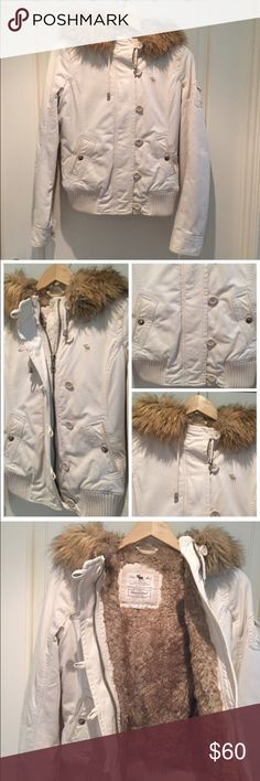 AF faux fur-lined winter jacket Super cozy/warm and a great winter coat/jacket! White/Light khaki color. Fur around hood can be removed. Pre-loved but in excellent condition. A few tiny spots but barely noticeable (see photos). Recently dry cleaned. Abercrombie & Fitch Jackets & Coats