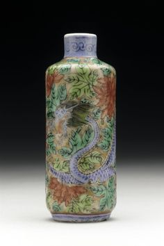 Snuff Bottle (Biyanhu) with Dragon and Flowers China, Chinese, late Qing dynasty, about 1800-1911 Tools and Equipment; bottles Porcelain with underglaze copper red, overglaze enamels, and gilt decoration Height: 3 1/2 in. (8.9 cm); Width: 1 1/8 in. (2.9 cm) Gift of Albert G. Wassenich (35.9.190a-b) Chinese Art