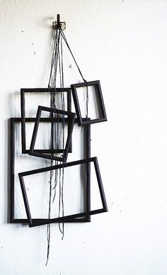Frames hung from string. Neat visual interest piece. Takes a bit of arranging and a lot of glue to get this result. #home #deco #DIY #wall