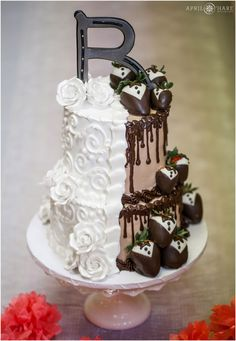 Half and half wedding cake by Azucar with vanilla and chocolate frosting and chocolate covered strawberries at a Colorado wedding reception