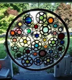 Stained glass bicycle wheel  recycled by VeloGioielli on Etsy.....I see possibilities.....Got the parts.....Glass melts at what temp?