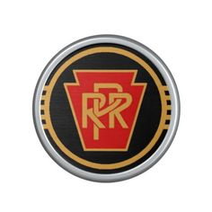 Pennsylvania Railroad Logo Speaker - $44.95 ----------- Bump up the volume of your favorite jams with the Bumpster, a portable speaker by OrigAudio. Featuring Bluetooth and NFC, simply tap your phone against the speaker for instant pairing. Speaker gives you full music quality and lets you switch tracks from across the room! The Bumpster is designed with a rechargeable battery that lasts up to 10 hours and a built in microphone to make hands-free phone calls in your vehicle or wherever you…