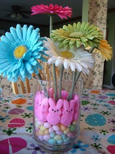 Easter centerpiece with peeps, jelly beans, and flowers.