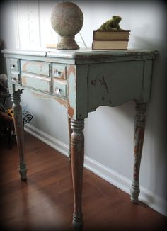 Antique sewing cabinet refurbished into a console table.  MMS milk paint