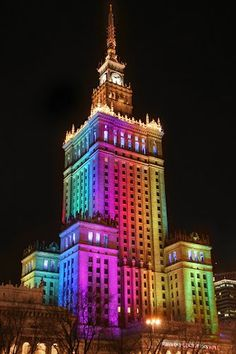 Palace of Culture and Science, Warsaw. Lit up and full of color, making a marked contrast against the pitch-black night sky.