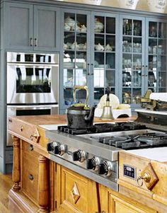 """BENJAMIN MOORE WOLF GRAY 2127-40: """"I'm so tired of all those off-white cabinets. I'd paint them this dark Swedish gray-blue, and make the whole room very Gustavian, with chalky white walls, Carrara marble countertops, and stainless-steel appliances."""" -Sandra Nunnerly   - HouseBeautiful.com"""