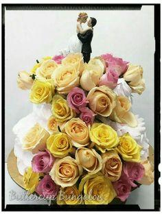 Fresh rose wedding cake.