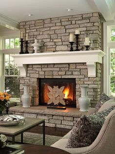 Fireplace Stone White Grey Wall Framed Porcelains Beside Steel Table Flower the Pillows on the Sofas