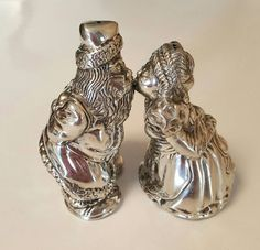 Check out this item in my Etsy shop https://www.etsy.com/listing/475769970/kirk-stieff-pewter-716-kissing-santa-and