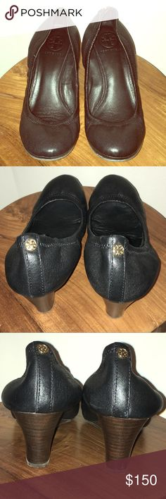 Tory Burch Black Wedge Sz 7.5 Elastic back Tory Burch Black wedges with a dark wooden wedge and a rubber sole, in a size 7.5 (non-skid sole YAY!). These are so comfortable and stylish with the cutest little Tory Burch signature logo emblem on the back of each shoe. Seriously, these are classic and adorable! Please see all photos for condition.   All my items come from a smoke free home. Tory Burch Shoes Wedges