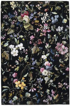 Design for a printed cotton by William Kilburn. Floral design on a black background. A remarkable feature of the design is the concentration of flowers at the top right which consists of a fantastic white flower and a pink rose-like flower which both have green centres. ca. 1788-1792 (made)