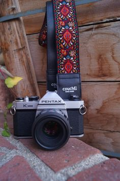 This bohemian trim woven camera strap is the exact pattern of jacquard fabric often referred to as the Hendrix pattern, and is a true American classic rumored to be worn by the man himself. These weaves adorned fabrics, guitar straps, camera straps and the like in the Bohemian hippie era of the early 1970s and have returned to prominence today. Although this pattern and look is definitively vintage, this is a new quality camera strap made Made in The USA of new and recycled materials. We sew…