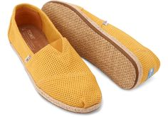 Add some citrus to your step with these TOMS Orange Freetown Women's Classics.