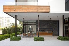 Covered modern outdoor kitchen - Decoist