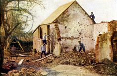 Four men working on a house that was severely damaged during the Battle of the Marne east of Paris, September 1914 (autochrome)
