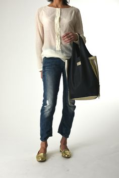 Leather shopping bag with zip. Move on from synthetics to bi-color natural leathers in simple stylish shapes.