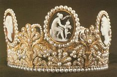 This beautifil Napoleonic-era cameo tiara was worn by Crown Princess Victoria of Sweden on her wedding day, just as her mother and two of her father's sisters had.  She also wore the earrings and bracelet that go with the Cameo parure