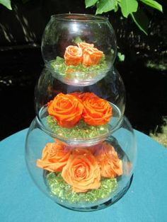 Three Tiered Bubble Vases Centerpiece .  I like the idea of this with a slight color variation, could easily be done in the tall vase.