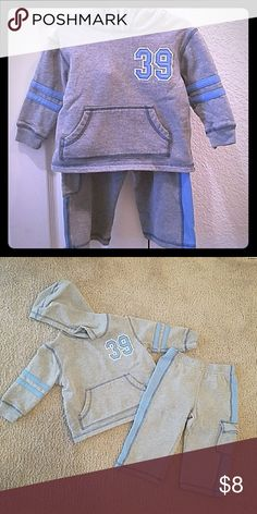 Boys 2T Wonder Kids Sweat Suit This grey and light blue boys outfit is adorable for the fall season. The grey hoodie has blue striping on the arms, and embellished 39 on the chest and a front kangaroo pocket. The matching grey pants habe the blur lines down each side and a cute pocket on the left leg! wonder kids Matching Sets